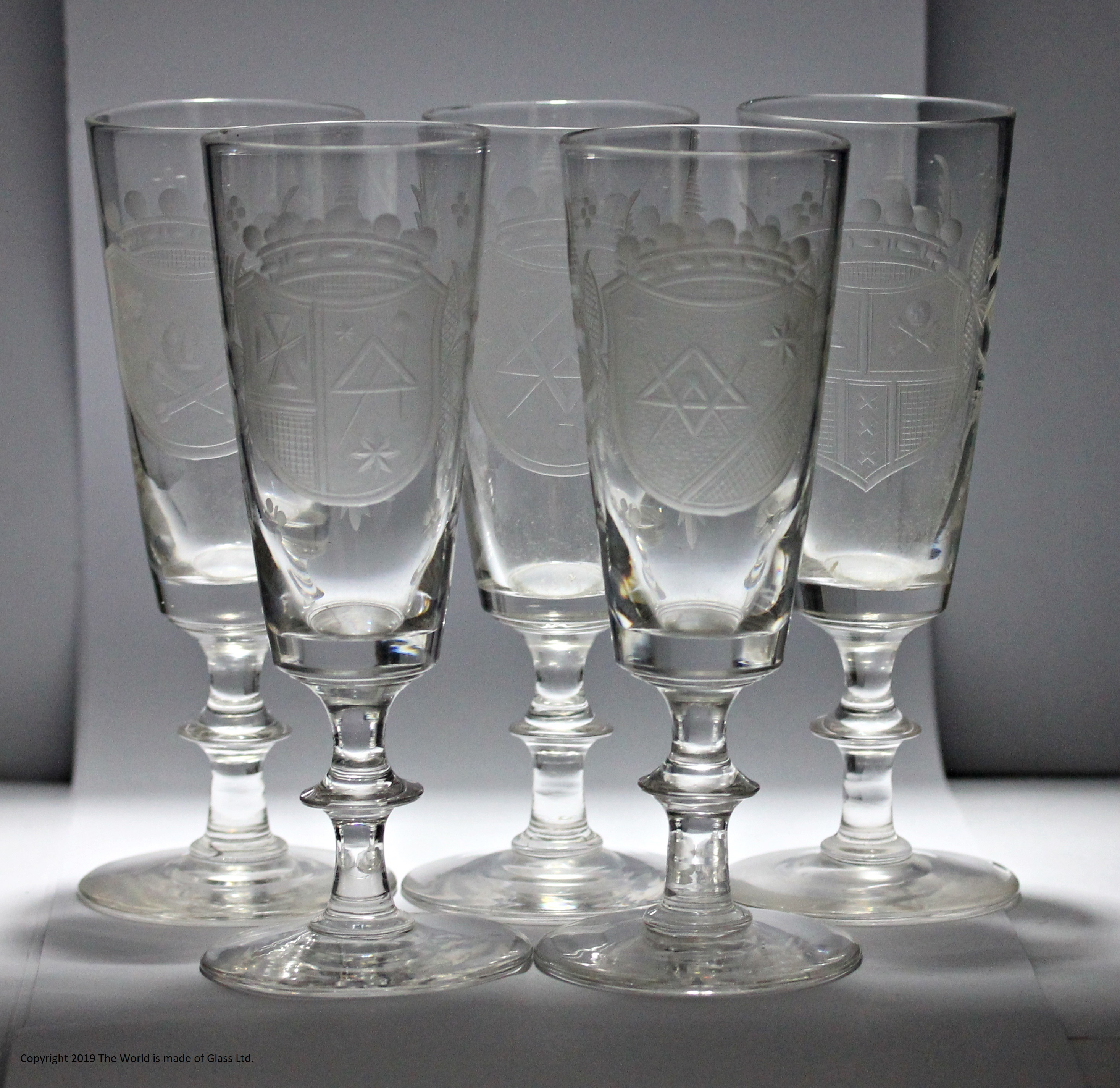 Set of five Victorian Masonic armorial engraved ale glasses