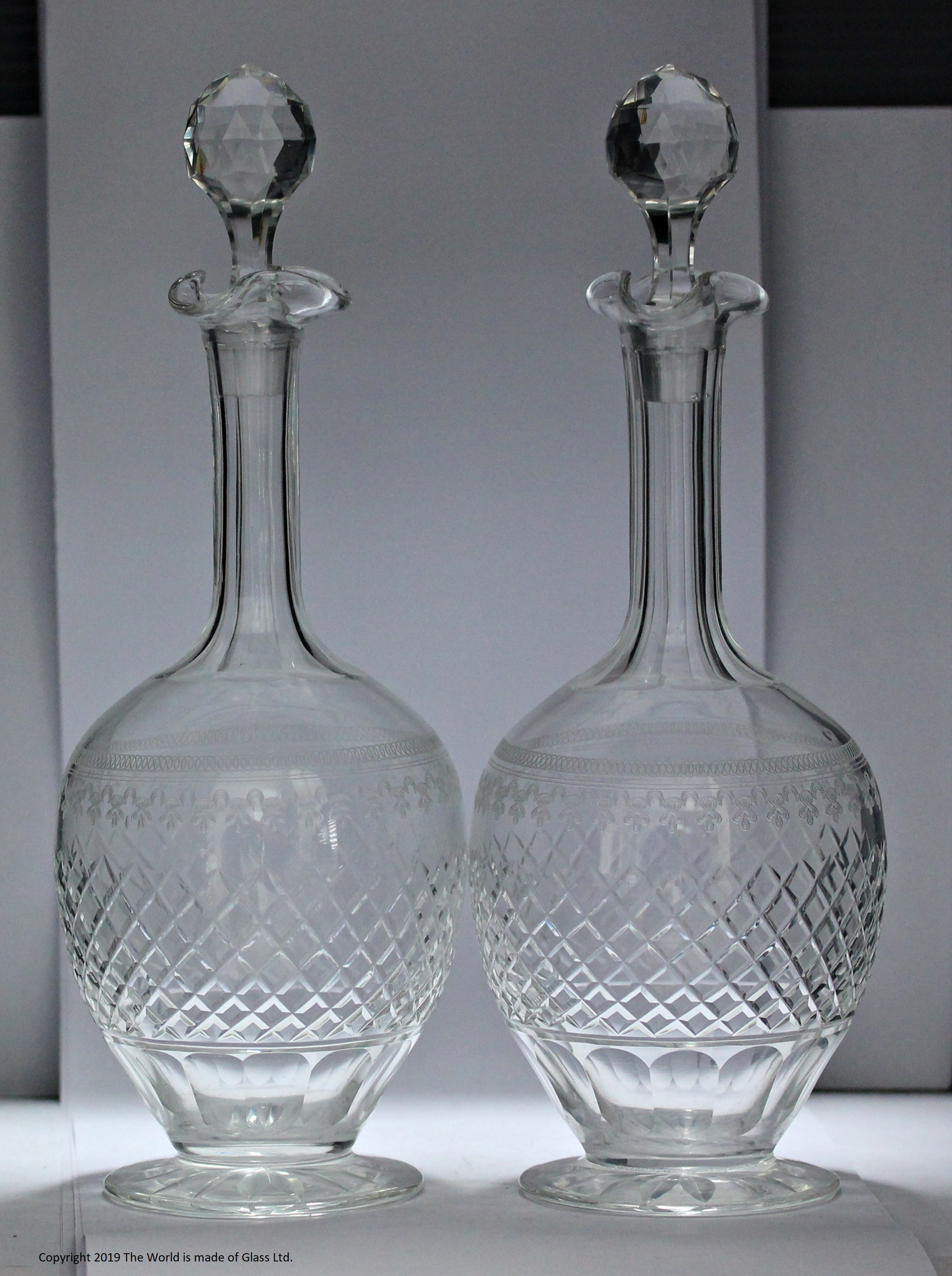 Pair of Pall Mall/Lady Hamilton pattern shaft and globe decanters