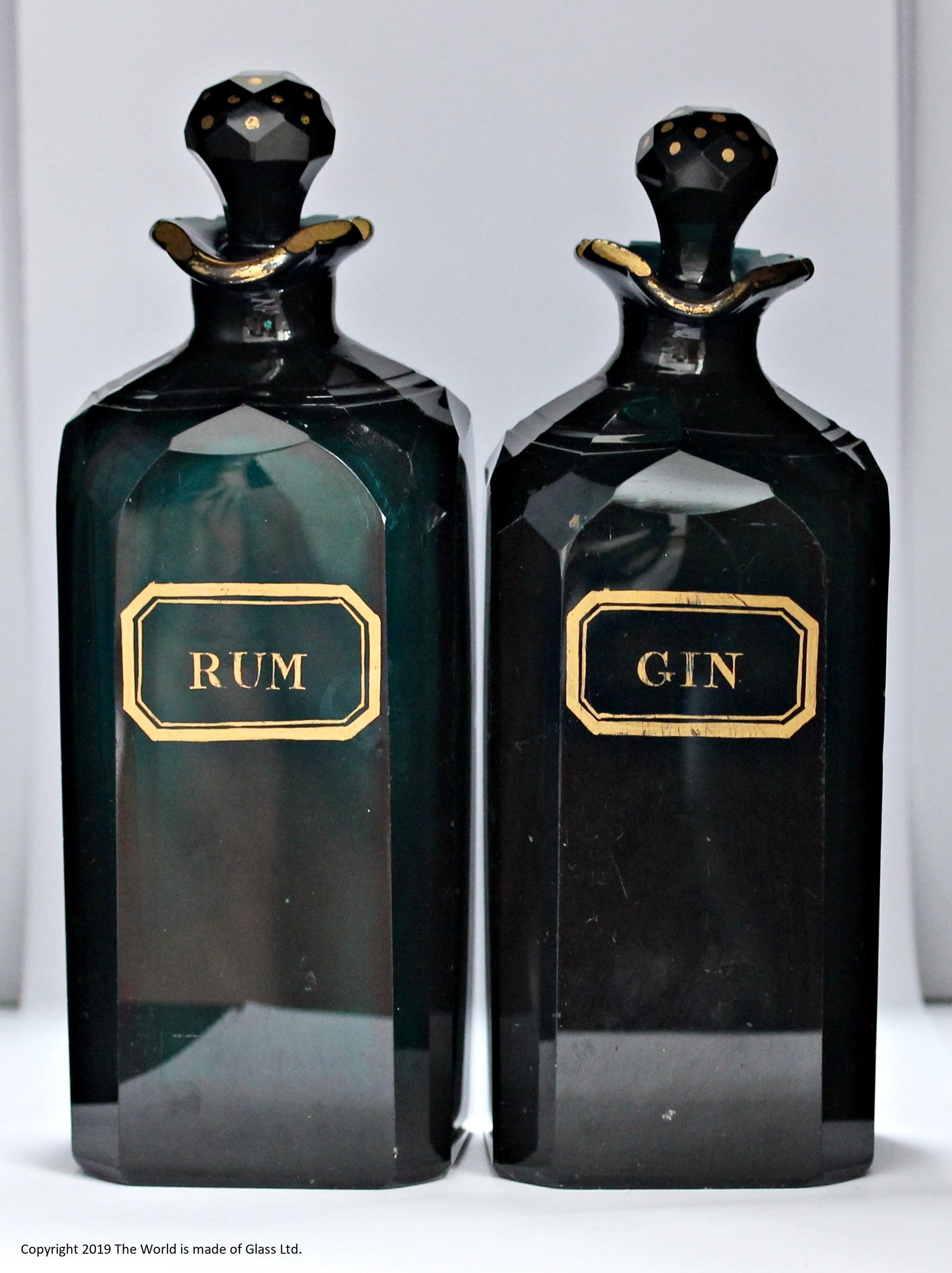 Pair of late Georgian Bristol green case decanters