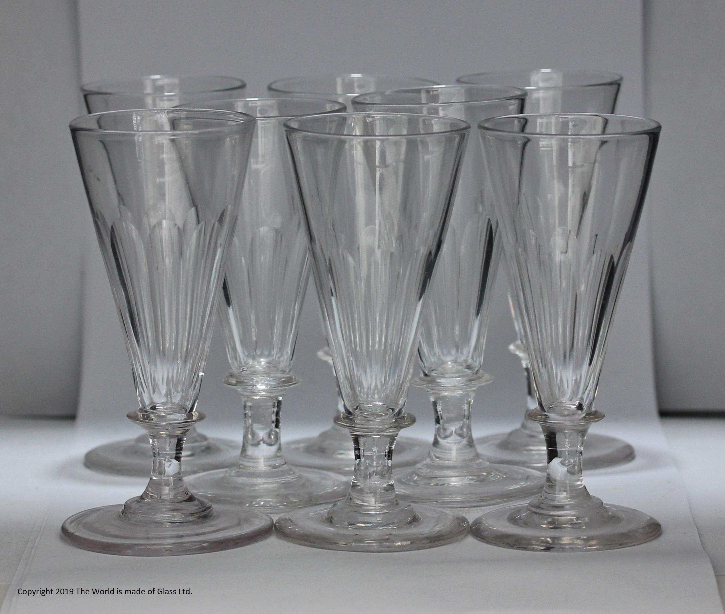 Set of eight late Georgian flute-cut dwarf ale glasses