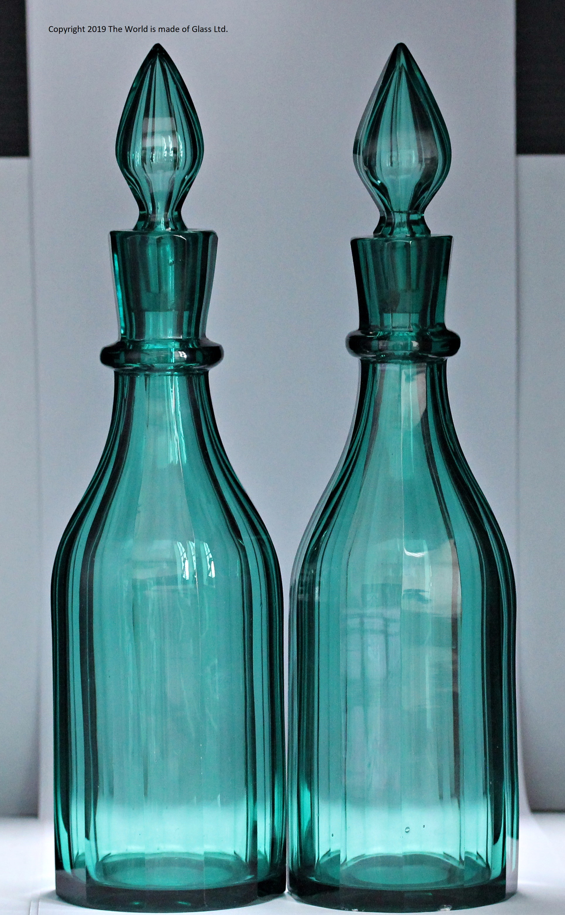 Pair of early Victorian Richardsons panel cut green glass decanters