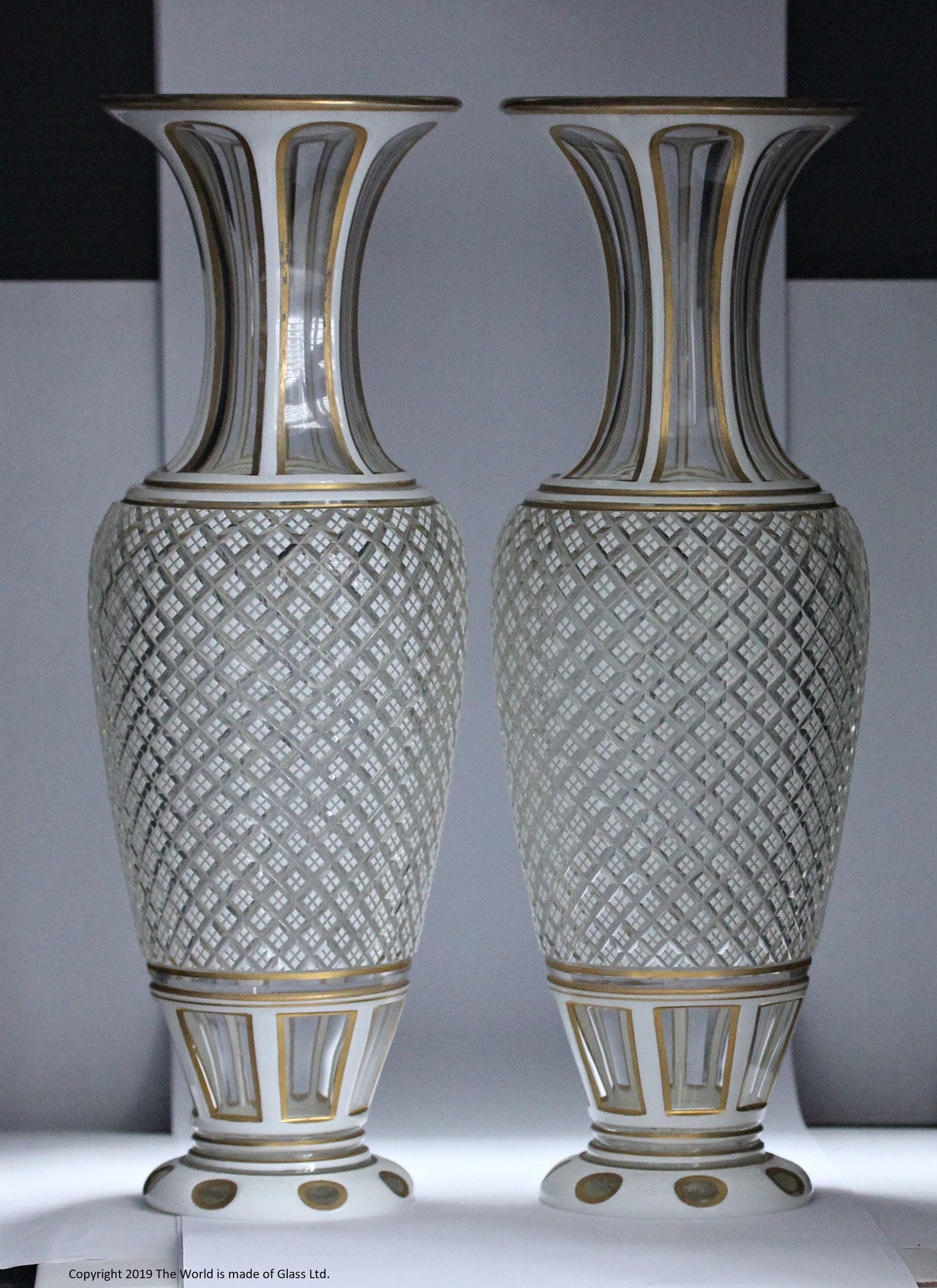 Pair of large Victorian Bohemian white cased cut-to-clear vases